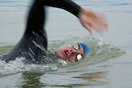 Triathlete swimming in the Boulder Reservoir in Boulder, CO