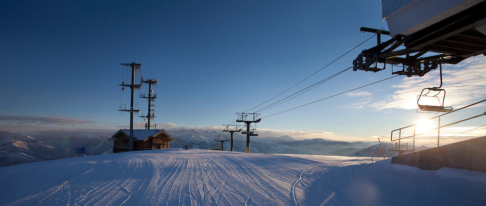 Sunrise graces the top of Callenger chairlift on Bald Mountain, Sun Valley, ID