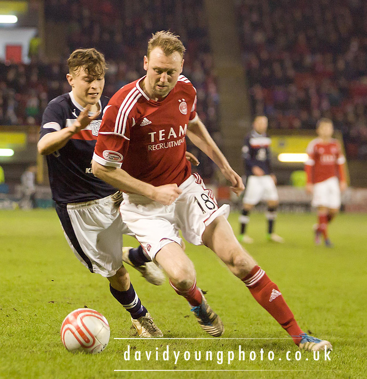 Aberdeen's Stephen Hughes and Dundee's Nicky Riley  - Aberdeen v Dundee, Clydesdale Bank Scottish Premier League at Pittodrie .. - © David Young - www.davidyoungphoto.co.uk - email: davidyoungphoto@gmail.com