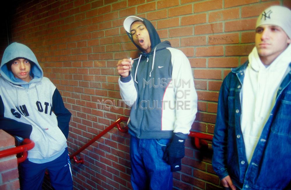 Three teenage boys smoking spliff, London, 2003