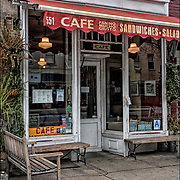 It is too cold in December but for most of the year you can find people sitting on  benches outside their local coffee place watching both the tourist and locals walk by as they make up stories about them as they enjoy their coffee. <br /> <br /> Cafe Panino Mucho Giusto at 551 Hudson Street near Perry Street