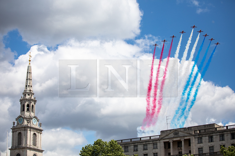 © Licensed to London News Pictures. 08/06/2019. London, UK. The Red Arrows perform a fly past as part of Trooping the Colour, a ceremony to mark Queen Elizabeth II official birthday. Photo credit : Tom Nicholson/LNP