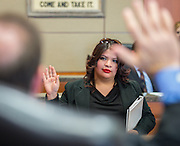 Davis High School student Lesly Cardoza participates in a mock trail at the Harris County Civil Courthouse, July 30, 2014.