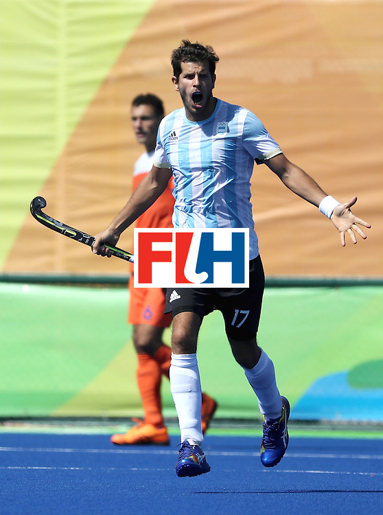 RIO DE JANEIRO, BRAZIL - AUGUST 06:  Juan Lopez #17 of Argentina reacts to scoring a goal during a Pool B match between Argentina and Netherlands on Day 1 of the Rio 2016 Olympic Games at the Olympic Hockey Centre on August 6, 2016 in Rio de Janeiro, Brazil.  (Photo by Sean M. Haffey/Getty Images)