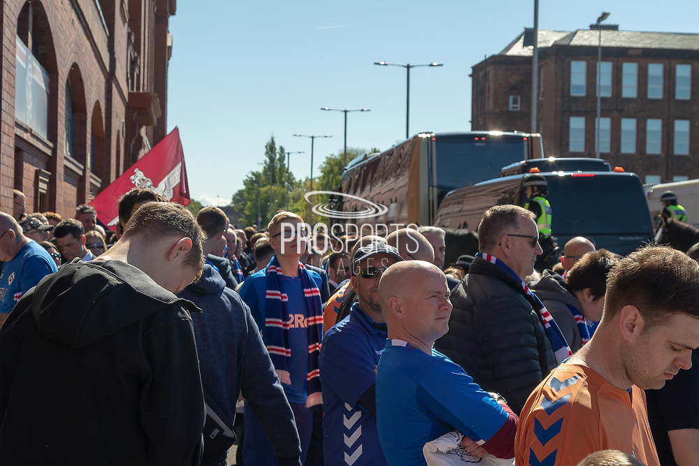Fans gather outside Ibrox awaiting the arrival of the team bus ahead of the Ladbrokes Scottish Premiership match between Rangers and Celtic at Ibrox, Glasgow, Scotland on 12 May 2019.