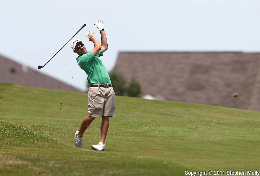 Joey Lamielle of Sarasota, Florida lets go of his club after a shot on the 9th hole during the first round of the Greater Cedar Rapids Open held at Hunters Ridge Golf Course in Marion on Friday, July 22, 2011.