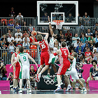 02 August 2012: Russia Andrei Kirilenko goes for the layup against Brazil Nene Hilario during 75-74 Team Russia victory over Team Brazil, during the men's basketball preliminary, at the Basketball Arena, in London, Great Britain.