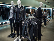 15 OCTOBER 2016 - BANGKOK, THAILAND:  Mannequins dressed in mourning black for Bhumibol Adulyadej, the King of Thailand, in EmQuartier mall in Bangkok. King Bhumibol Adulyadej died Oct. 13, 2016. He was 88. His death comes after a period of failing health. With the king's death, the world's longest-reigning monarch is Queen Elizabeth II, who ascended to the British throne in 1952. Bhumibol Adulyadej, was born in Cambridge, MA, on 5 December 1927. He was the ninth monarch of Thailand from the Chakri Dynasty and is known as Rama IX. He became King on June 9, 1946 and served as King of Thailand for 70 years, 126 days. He was, at the time of his death, the world's longest-serving head of state and the longest-reigning monarch in Thai history.     PHOTO BY JACK KURTZ