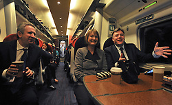 © Licensed to London News Pictures. 16/03/2012. London, UK. (Left to right) Ivan Lewis MP, Harriet Harmen and Ed Balls MP. Leader of the Labour Party, Ed Miliband and members of his Shadow Cabinet travel to Labour's Youth Conference in Coventry this morning, 16 March 2012, by train from London Euston Station. Photo credit : Stephen SImpson/LNP