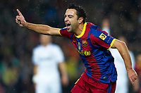 BARCELONA, SPAIN - NOVEMBER 29: Joy Xavi Hernandez of Barcelona during the La Liga match between Barcelona and Real Madrid at the Camp Nou Stadium on November 29, 2010 in Barcelona, Spain. (Photo by Manuel Queimadelos/DPPI)