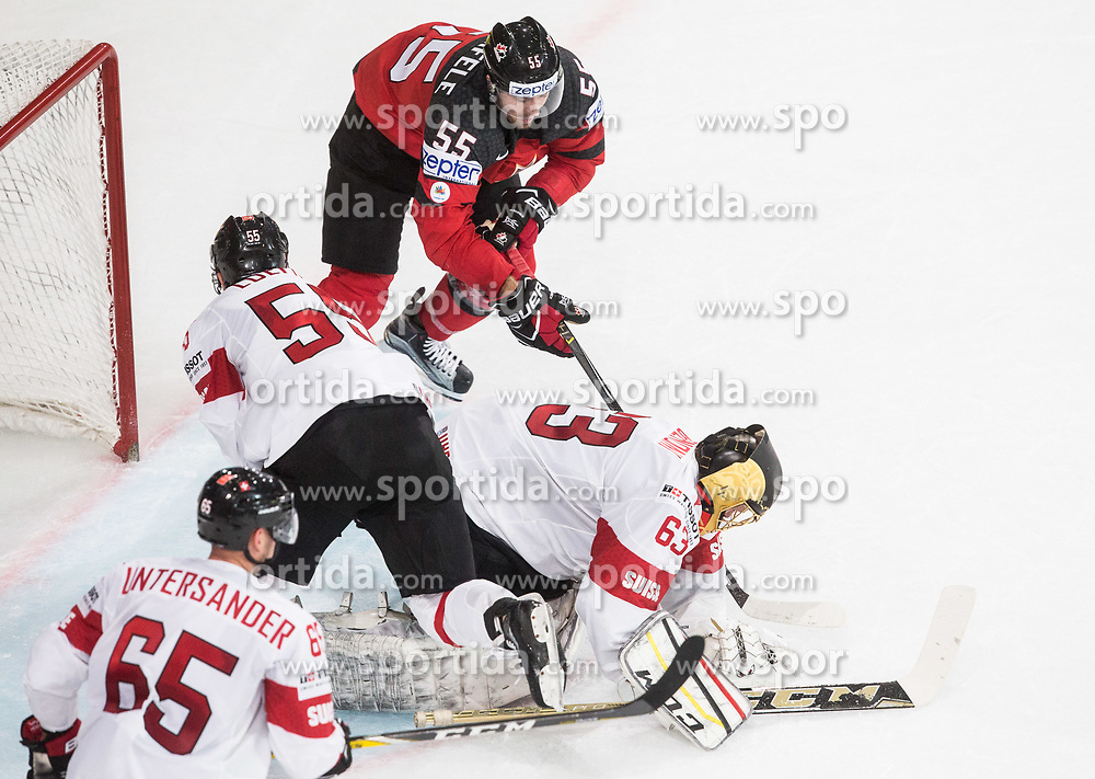 Mark Scheifele of Canada vs Romain Loeffel of Switzerland and Leonardo Genoni of Switzerland during the 2017 IIHF Men's World Championship group B Ice hockey match between National Teams of Canada and Switzerland, on May 13, 2017 in AccorHotels Arena in Paris, France. Photo by Vid Ponikvar / Sportida