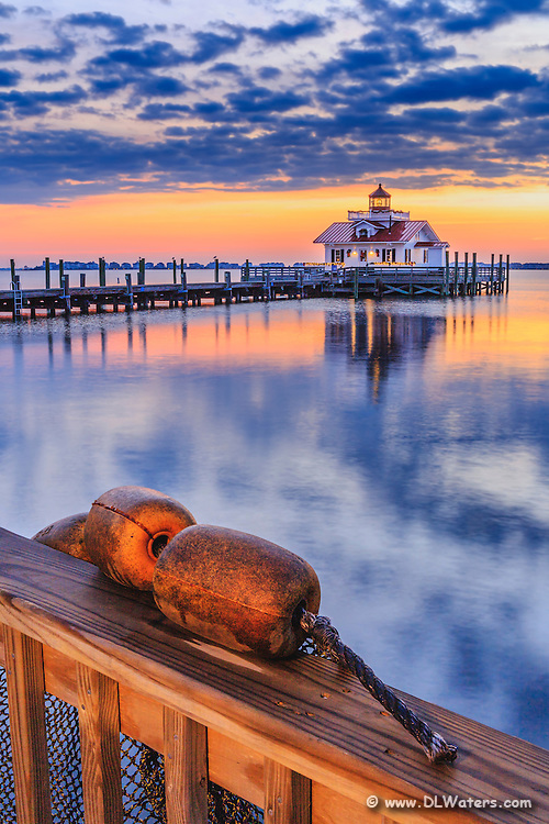 Roanoke Marshals Lighthouse and buoys at sunrise on the Outer Banks.