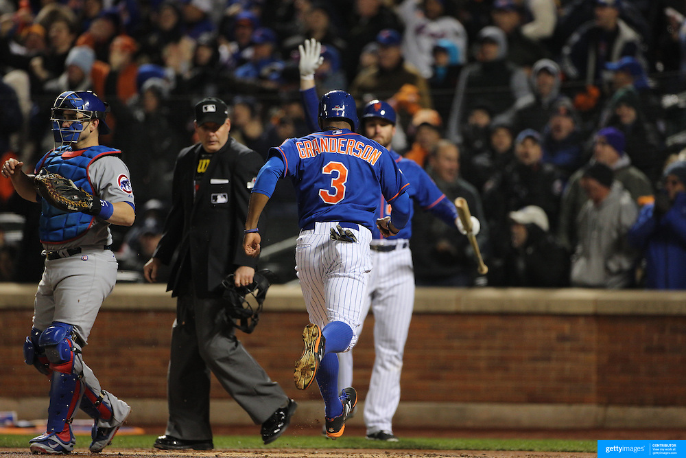 Curitis Granderson, scoring a run for the New York Mets, is congratulated by Daniel Murphy during the MLB NLCS Playoffs game two, Chicago Cubs vs New York Mets at Citi Field, Queens, New York. USA. 18th October 2015. Photo Tim Clayton