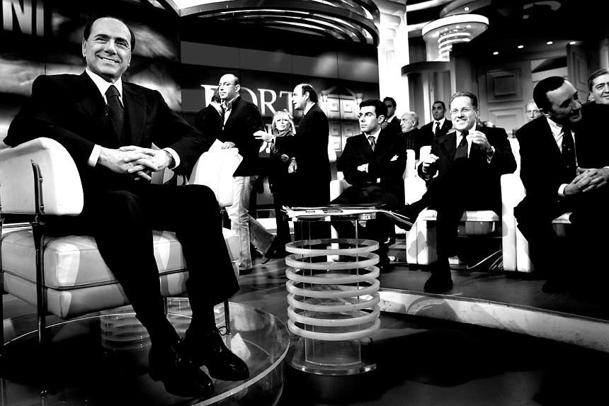 "Italian Prime Minister Silvio Berlusconi smiles as he prepares to star at the italian ""RAI"" studios in a politic talk show.The italian politics leader made his first TV appereance after 8 months, to draw a balance of his five years government and to welcome the resignation of Bank of Italy Governor Antonio Fazio."