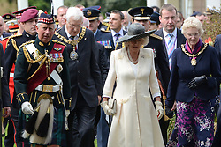 © licensed to London News Pictures. Edinburgh, UK, 25/06/2011. Prince Charles and the Duchess of Cornwall - known by the title Duke and Duchess of Rothesay in Scotland - leave the grounds of Holyrood Palace to mingle with crowds at Armed Forces Day. Please see special instructions for usage rates. Photo credit should read Ken Jack/LNP