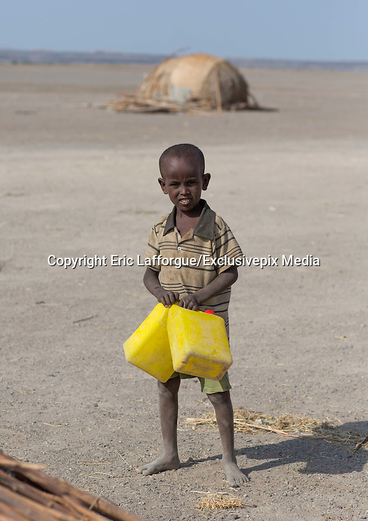 SCHOOL BACKPACKS VERSUS WATER JERRICANS<br /> <br /> There are 3 million Afar people spread across 3 countries in the Horn of Africa: Ethiopia, Eritrea and Djibouti. In the northeast of Ethiopia, in the area of Semera, Afar children are happy to go to school. But each day, they are unsure if they will be able to attend class as for months now, they have had to carry out a vital task first: searching for water. <br /> For their families and for themselves, to bring to school with them.<br /> In the arid territory where they live, they have been suffering the most severe drought in 50 years according to the United Nations.<br /> <br /> In the fields around the main river, named the Awash, everything appears to be fine – corn is everywhere. It is just strange seeing camels and cows grazing in the fields.<br /> But if you look closer, you can see that the plants are very small. This is the green drought – the area experiences a period of limited rainfall which causes new but insubstantial plant growth.<br /> Scientists say that the El Niño phenomenon is responsible for this tragedy. <br /> So, people let their camels and cows wander into the fields and graze the plants.<br /> It is January and Afar has not received one drop of rain for the last 3 months.<br /> <br /> Schoolchildren leave their small villages early in the morning, when the sun is not too harsh yet. Many will walk for an hour before reaching the first pump, which is 1 kilometer away from the school. If they are lucky, they will find water. If not, they will have to walk another 5 kilometers – for nearly 2 hours – to get to another pump. Provided that the well is not dry or the pump is not broken, they will then be able to go to school with their yellow jerricans filled with water.<br /> <br /> In school, the water is used to do some cleaning – dust is everywhere and covers the children's faces. It is also used for the toilets and of course for drinking, as temperatures can rise up to 40 degrees. The child