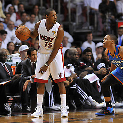 Jun 17, 2012; Miam, FL, USA; Miami Heat point guard Mario Chalmers (15) dribbles against Oklahoma City Thunder point guard Russell Westbrook (0) during the first quarter in game three in the 2012 NBA Finals at the American Airlines Arena. Mandatory Credit: Derick E. Hingle-US PRESSWIRE