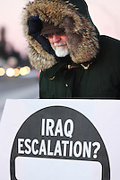 JEROME A. POLLOS/Press..John Beecher faces the bitter cold weather Thursday to protest the recent decision by President Bush to further escalate the number of troops in Iraq.