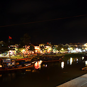 A night scene showing the waterfront and nightlife in Hoi An, Vietnam. Hoi An is an ancient town and an exceptionally well-preserved example of a South-East Asian trading port dating from the 15th century. Hoi An is now a major tourist attraction because of its history. Hoi An, Vietnam. 5th March 2012. Photo Tim Clayton
