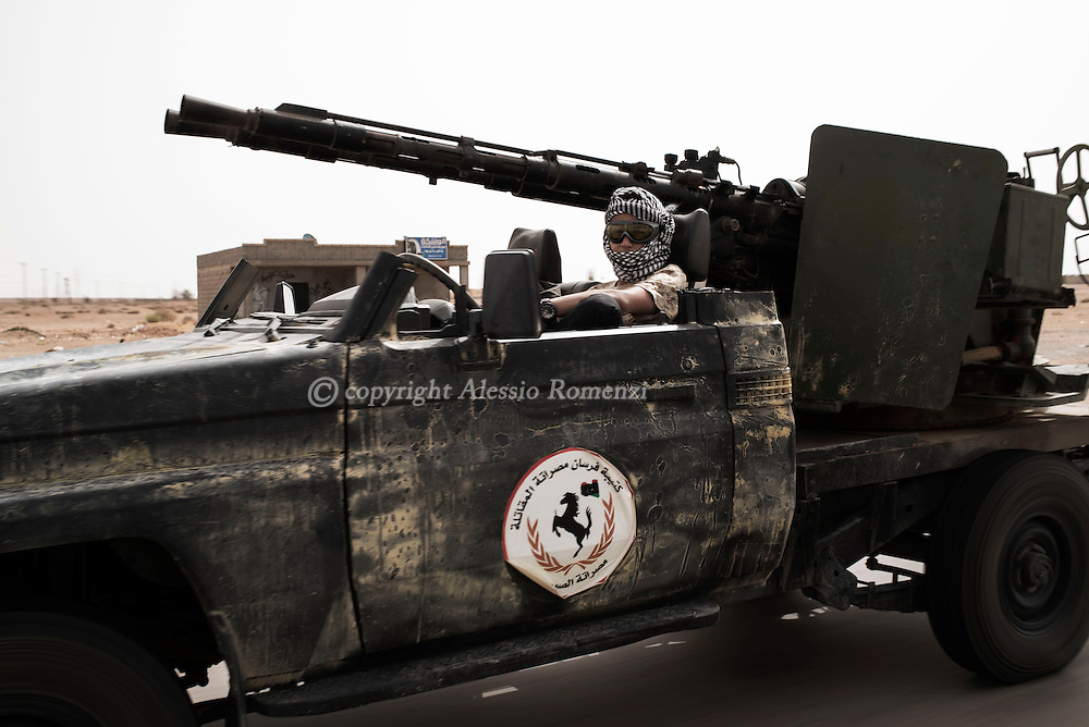 Libya: A Libya's Government of National Accord's (GNA) pickup with a machine gun mounted on the rear is seen as it moves toward Sirte. Alessio Romenzi