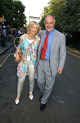 MICHAEL & SANDRA HOWARD at Sir David & Lady Carina Frost's annual summer party held in Carlyle Square, Chelsea, London on 5th July 2006.<br />