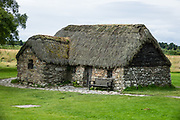 Leanach thatched cottage built in early 1700s on the grounds of Culloden Battlefield. The Culloden Battlefield visitor center is run by the National Trust for Scotland, near Inverness, United Kingdom, Europe. The Battle of Culloden on 16 April 1746 was part of a religious civil war in Britain and was the final confrontation of the Jacobite rising of 1745. It was the last pitched battle on British soil, and in less than an hour about 1500 men were slain – more than 1000 of them Jacobites. After an unsuccessful Highland charge against the government lines, the Jacobites were routed and driven from the field. Today, strong feelings are still aroused by the battle and the brutal aftermath of weakening Gaelic culture and undermining the Scottish clan system. Three miles south of Culloden village is Drumossie Moor, often called Culloden Moor, site of the battle. Culloden is in Scotland 5 miles east of Inverness, off the A9/B9006, directed by brown signs.
