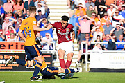 Northampton Town midfielder Daniel Powell (11) has his shot blocked during the EFL Sky Bet League 1 match between Northampton Town and Oldham Athletic at Sixfields Stadium, Northampton, England on 5 May 2018. Picture by Dennis Goodwin.