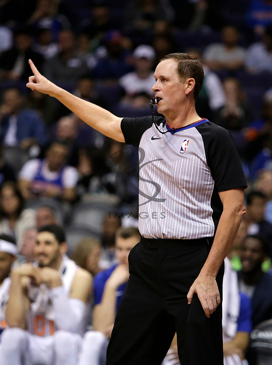 NBA official Matt Boland in the first half during an NBA basketball game between the New York Knicks and the Phoenix Suns, Friday, Jan. 26, 2018, in Phoenix. (AP Photo/Rick Scuteri)