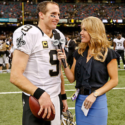 Sep 21, 2014; New Orleans, LA, USA; New Orleans Saints quarterback Drew Brees (9) talks to Fox sideline reporter Jennifer Hale following a win against the Minnesota Vikings in a game at Mercedes-Benz Superdome. The Saints defeated the Vikings 20-9. Mandatory Credit: Derick E. Hingle-USA TODAY Sports