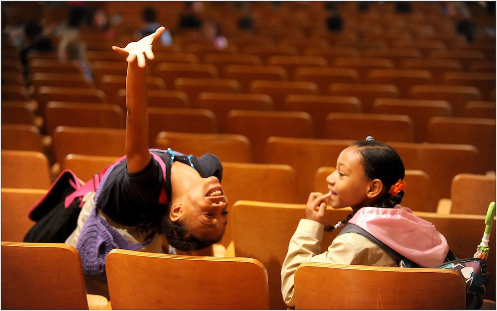 Zymira Rogers (left) and India Poindexter laugh together before the start of school.