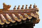 Gugong (Forbidden City, Imperial Palace). Figures of an immortal on a phenix, fabled creatures and a dragon's head on the roofs.