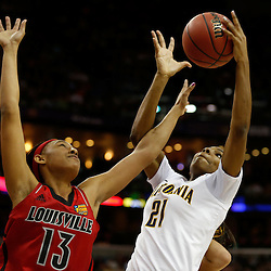 April 7, 2013; New Orleans, LA, USA; California Golden Bears forward Reshanda Gray (21) grabs a rebound against Louisville Cardinals forward Cortnee Walton (13) during the first half in the semifinals during the 2013 NCAA womens Final Four at the New Orleans Arena. Mandatory Credit: Derick E. Hingle-USA TODAY Sports