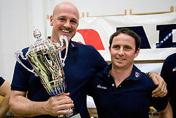 Coaches of ACH Glenn Hoag and Tilen Kozamernik with a Trophy after the final match of Slovenian National Volleyball Championships between ACH Volley Bled and Salonit Anhovo, on April 24, 2010, in Radovljica, Slovenia. ACH Volley defeated Salonit 3rd time in 3 Rounds and became Slovenian National Champion.  (Photo by Vid Ponikvar / Sportida)