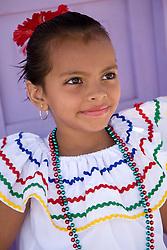 Central America, Nicaragua, Granada.  Girl in traditional dress after dance in Villa Esperanza barrio.  MR