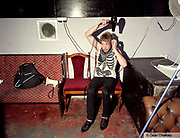 Oliver, styling his hair, backstage at The Junk Club, Southend, UK 2006