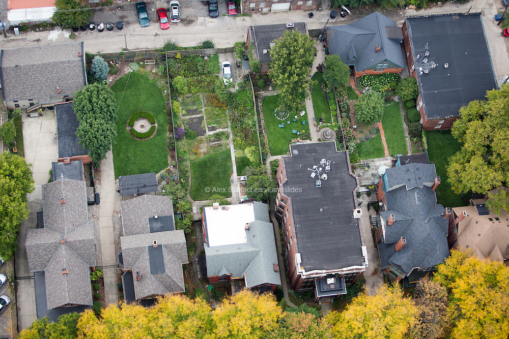Backyard lawns and gardens to historic houses in the West Canfield Historic District
