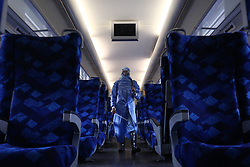 March 17, 2020, Colombo, Sri Lanka: A Sri Lankan worker sprays wearing protective gear spray disinfectant Inside a train at Dematagoda railway yard in Colombo. The Sri Lankan government declared March 17 to 19 public holiday following the rapid rise of coronavirus positive cases in the country. (Credit Image: © Pradeep Dambarage/ZUMA Wire)