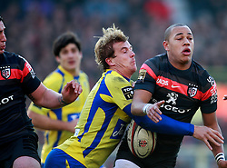 Aurelin Rougerie of Clermont tackles Gael Fickou. Stade Toulousain v ASM Clermont Auvergne, Top 14, Stade Municipal, Toulouse, France, 1st December 2012.