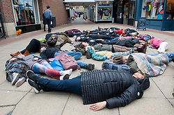 © Licensed to London News Pictures. 27/04/2019.<br /> Sevenoaks,UK. As part of an International die-in event today, the newly formed Extinction Rebellion Sevenoaks group have staged a die-in protest in the town centre at the pedestrian area of the High Street in Kent.
