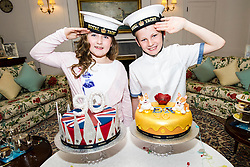 "Pictured: Lucy Kearney (8) and Alfie Bennet (11)<br /> <br /> Chefs Tom Kitchin and Vicki Tighe presented primary pupils Alfie Bennet and Lucy Kearney with nine-inch versions of their winning entries for the ""Design a Cake for The Queen's 90th Birthday"" competition on the Royal Yacht Britannia today. <br /> Ger Harley 