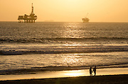 Couple Walking at Sunset in Huntington Beach