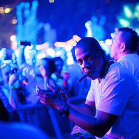 Jay-Z smokes a cigar listening to DeadMau5 perform at the Budweiser Made in America Music Festival in Philadelphia, PA on August 31, 2013.