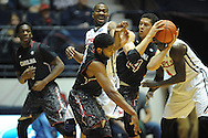 "Mississippi Rebels guard Ladarius White (10) collides into South Carolina Gamecocks forward Michael Carrera (24) while guarding South Carolina Gamecocks guard Sindarius Thornwell (0) at the C.M. ""Tad"" Smith Coliseum in Oxford, Miss. on Saturday, January 10, 2015. (AP Photo/Oxford Eagle, Bruce Newman)"