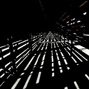 Light shines under the bleachers in the top section of the stands prior to the game at Harvard Stadium on May 17, 2014 in Boston, Massachuttes. (Photo by Elan Kawesch)