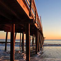 Image of waves breaking under the fishing pier at sunrise, Virginia Beach, Virginia.