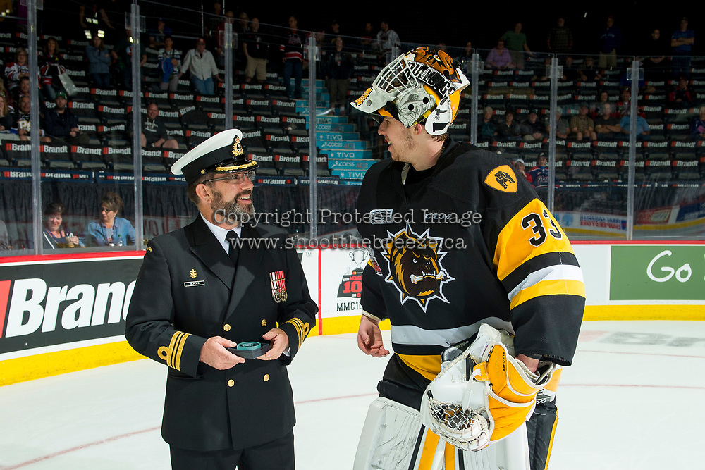 REGINA, SK - MAY 21: Kaden Fulcher #33 of Hamilton Bulldogs accepts the third star of the game against the Swift Current Broncos at the Brandt Centre on May 21, 2018 in Regina, Canada. (Photo by Marissa Baecker/CHL Images)