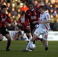 Photo: Matt Bright/Sportsbeat Images.<br /> AFC Bournemouth v Swindon Town. Coca Cola League 1. 29/12/2007.<br /> Simon Cox of Swindon &  Jean-François Christophe of Bournemouth