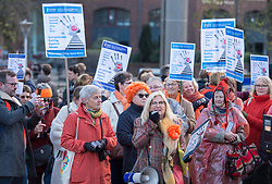 © Licensed to London News Pictures.  25/11/2017; Bristol, UK. Women's group The Soroptomists on Bristol's College Green at a rally against domestic violence and to campaign for healthy relationships. Under the banner 'Railing Against Abuse', members of the group travelled to Bristol by train on Saturday, November 25, before walking to College Green where they handed out leaflets entitled Loves Me, Loves Me Not in the shape of bookmarks and cards which offer a simple message about abusive relationships and a helpline for anyone who needs support. They were joined at College Green by Dame Joan Collins and her daughter Tara Newley Arkle, Lord Mayor Lesley Alexander, and Avon & Somerset Police and Crime Commissioner Sue Mountstevens. The march marks the United Nations' Elimination of Violence Against Women Day. Picture credit: Simon Chapman/LNP