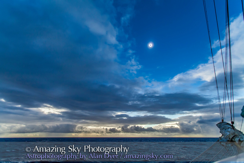 """Total eclipse of the Sun, November 3, 2013 as seen from a latitude of 16° 58' 50"""" North and 37° 10' 37"""" West in the middle of the Atlantic Ocean, from the Star Flyer sailing ship. I took this with a Canon 5D MkII and 16-35mm lens at 19mm for 1/40s at f/2.8 and ISO 800 on a heavily rolling ship. This is one frame near mid-totality of a 360+ time-lapse sequence."""