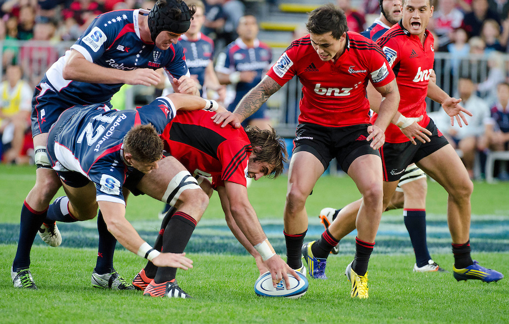Rebels Cadeyrn Neville, left and Rory Sidey tackle Crusaders Sam Whitelock in the Super Rugby match at AMI Stadium, Christchurch, New Zealand, Sunday, April 28, 2013. Credit:SNPA / David Alexander.